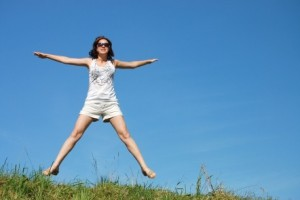 5345472 - girl jumping against the beautiful sky